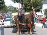 Ben and Bob pull Lawrence Kelly's wagon at the fair as he provides transportation around the village.