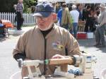 A wood-turner demonstrating his craft.