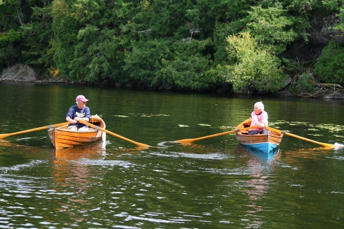 Frank and Sandy Ellis, enjoying a little jaunt in Lower Beverly Lake in their antique St. Lawrence River Skiffs.